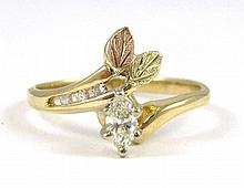 DIAMOND AND TEN KARAT GOLD RING. The yellow and