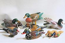 A COLLECTION OF NINE CARVED AND PAINTED WOOD