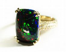 BLACK OPAL, DIAMOND AND FOURTEEN KARAT GOLD RING,