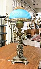 VICTORIAN CHERUB PARLOR LAMP having blue satin