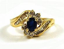 SAPPHIRE, DIAMOND AND TEN KARAT GOLD RING, with