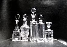 FIVE COLLECTIBLE CRYSTAL LIQUOR DECANTERS: one