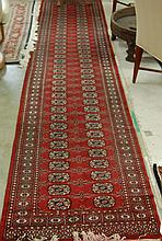 PAKISTANI BOKHARA RUNNER, hand knotted, the red