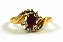 RUBY, DIAMOND AND TEN KARAT GOLD RING, with eight