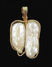 PEARL AND FOURTEEN GOLD PENDANT, featuring two
