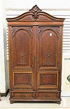 LOUIS XV STYLE CARVED WALNUT ARMOIRE, Vienna,