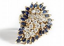 DIAMOND AND SAPPHIRE CLUSTER RING. The heavy 14k