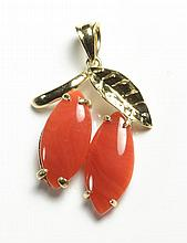 CORAL AND FOURTEEN KARAT GOLD PENDANT, set with