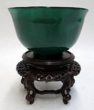 CHINESE GREEN AGATE BOWL on carved wood pedestal.