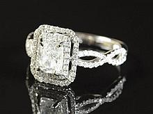 DIAMOND AND FOURTEEN KARAT WHITE GOLD RING, with