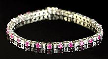 DIAMOND, RUBY AND EIGHTEEN KARAT GOLD BRACELET.