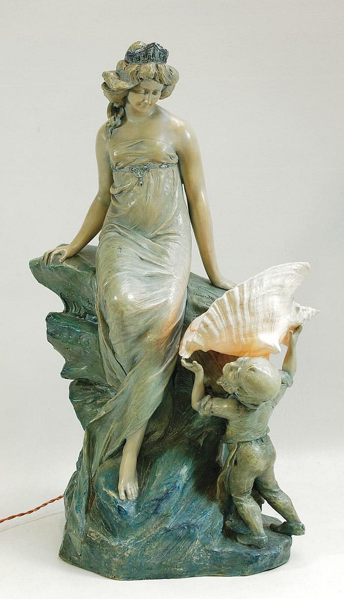 AN AUSTRIAN ART POTTERY FIGURAL TABLE LAMP. The