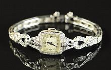LADY'S DIAMOND AND FOURTEEN KARAT WHITE GOLD