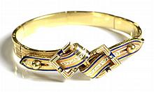 ENAMEL AND TWELVE KARAT GOLD BANGLE. The