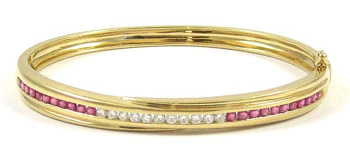 RUBY, DIAMOND AND EIGHTEEN KARAT GOLD BANGLE