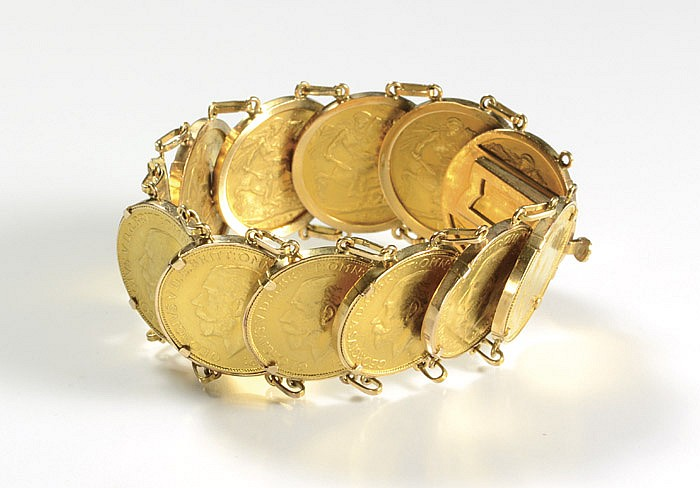 GOLD COIN AND FOURTEEN KARAT GOLD BRACELET,
