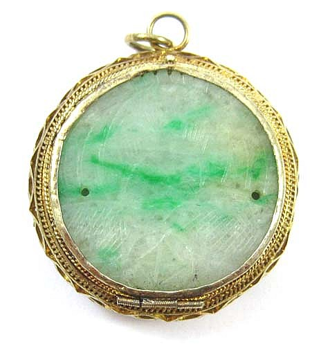 CHINESE ROUND JADE AND FOURTEEN KARAT GOLD PENDANT
