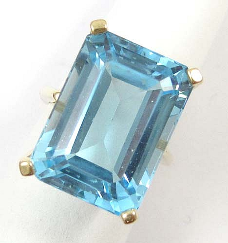 BLUE TOPAZ AND FOURTEEN KARAT GOLD SOLITAIRE RING,