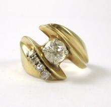 DIAMOND AND FOURTEEN KARAT GOLD RING, with four ro