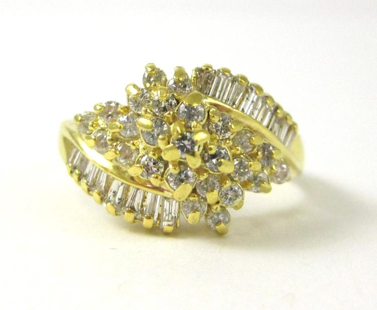 DIAMOND AND FOURTEEN KARAT GOLD CLUSTER RING, with