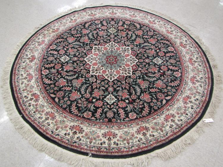 A ROUND ORIENTAL AREA RUG, Indo-Persian, floral an