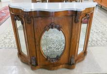 A VICTORIAN MARBLE-TOP WALNUT CONSOLE CABINET, Ame