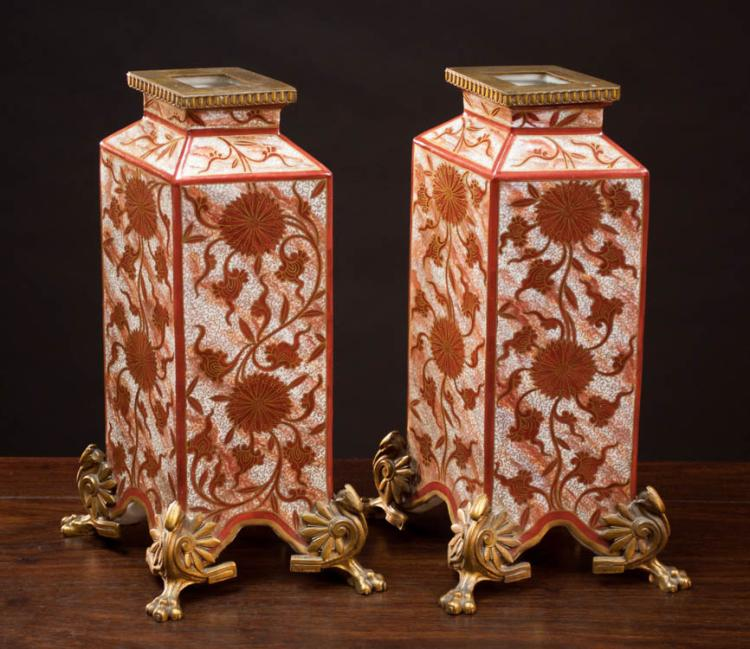 PAIR OF PORCELAIN VASES with gilt ormolu mounts.