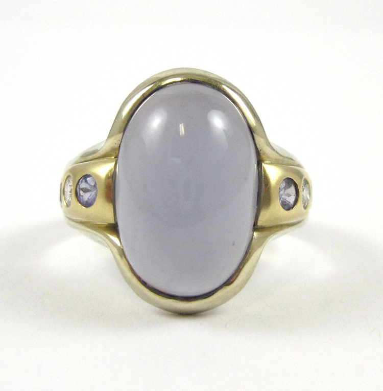 IOLITE, DIAMOND AND FOURTEEN KARAT GOLD RING, with