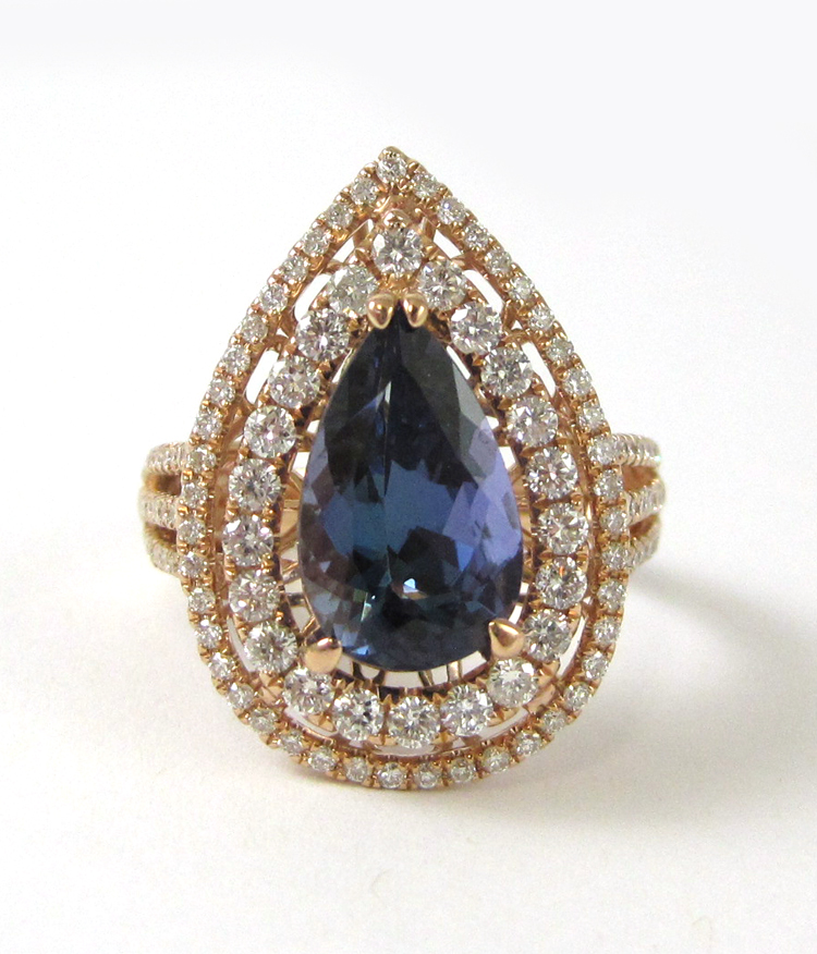TANZANITE AND FOURTEEN KARAT ROSE GOLD RING, with