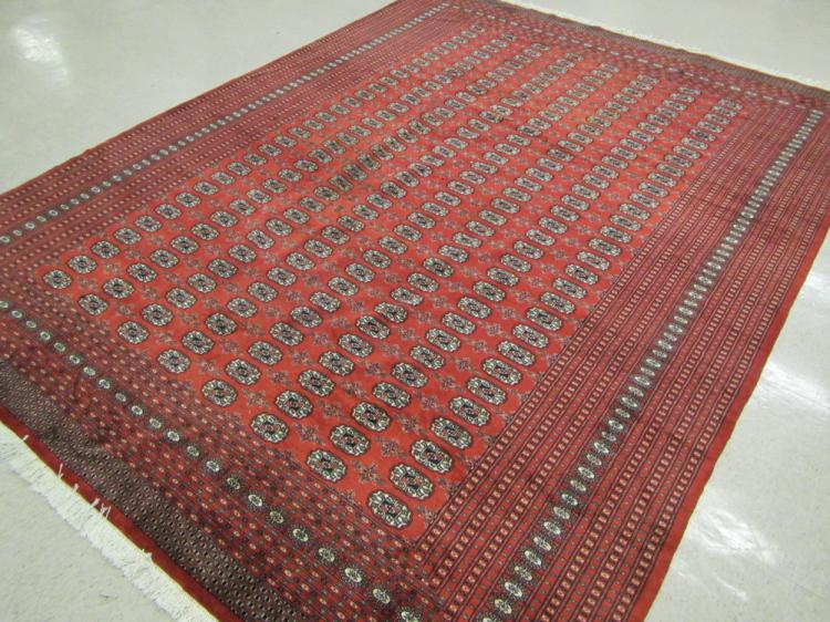 RED FIELD BOKHARA CARPET, Indo-Turkoman, repeating
