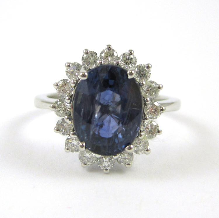 SAPPHIRE, DIAMOND AND FOURTEEN KARAT WHITE GOLD RI