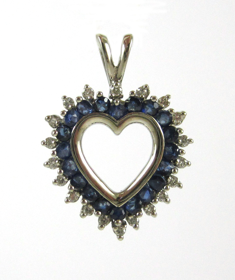 SAPPHIRE, DIAMOND AND FOURTEEN KARAT GOLD PENDANT.