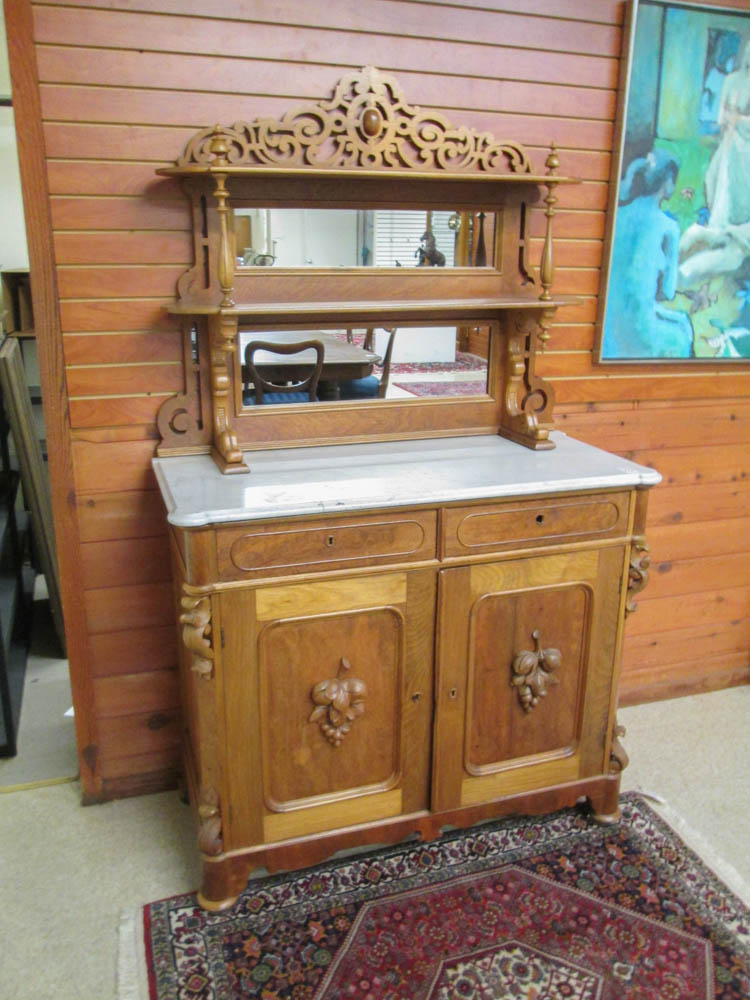 A VICTORIAN WALNUT SIDEBOARD, American, 19th centu