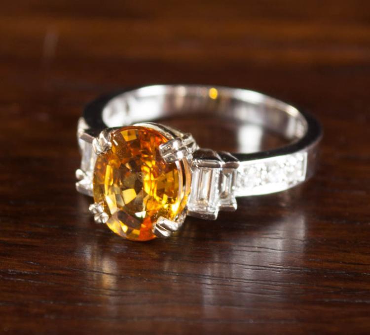 ORANGE SAPPHIRE AND DIAMOND RING, 14k white and ye