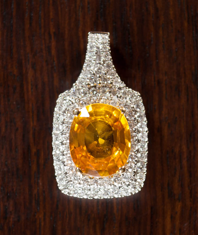 ORANGE SAPPHIRE AND DIAMOND PENDANT, 14k white gol