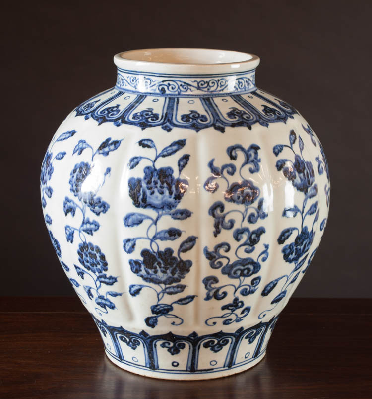 CHINESE MING STYLE BLUE AND WHITE VASE of bulbous
