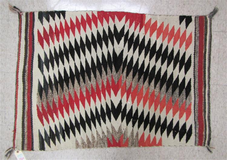 VINTAGE NAVAJO WEAVING having repeating parallelog