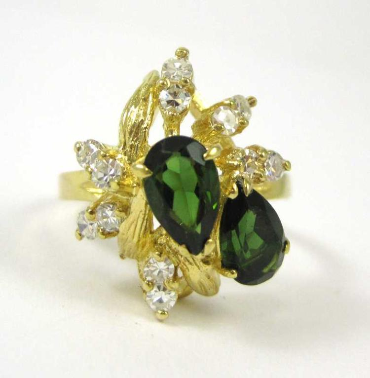 GREEN TOURMALINE AND FOURTEEN KARAT GOLD RING, set