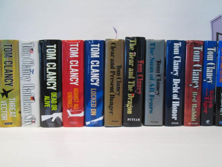 TWELVE HARDBACK TOM CLANCY BOOKS with dust jackets