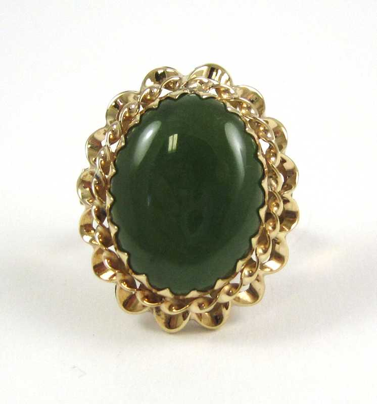 JADE AND FOURTEEN KARAT ROSE GOLD RING, set with a
