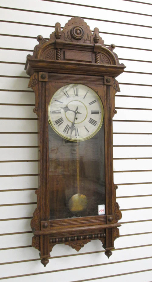 A LARGE OAK CASED WALL CLOCK,