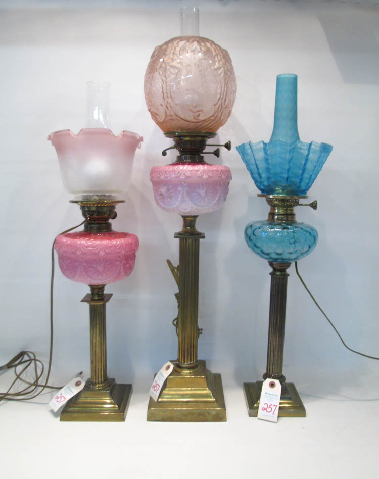 THREE ELECTRIFIED VICTORIAN FLUID OIL LAMPS, the f