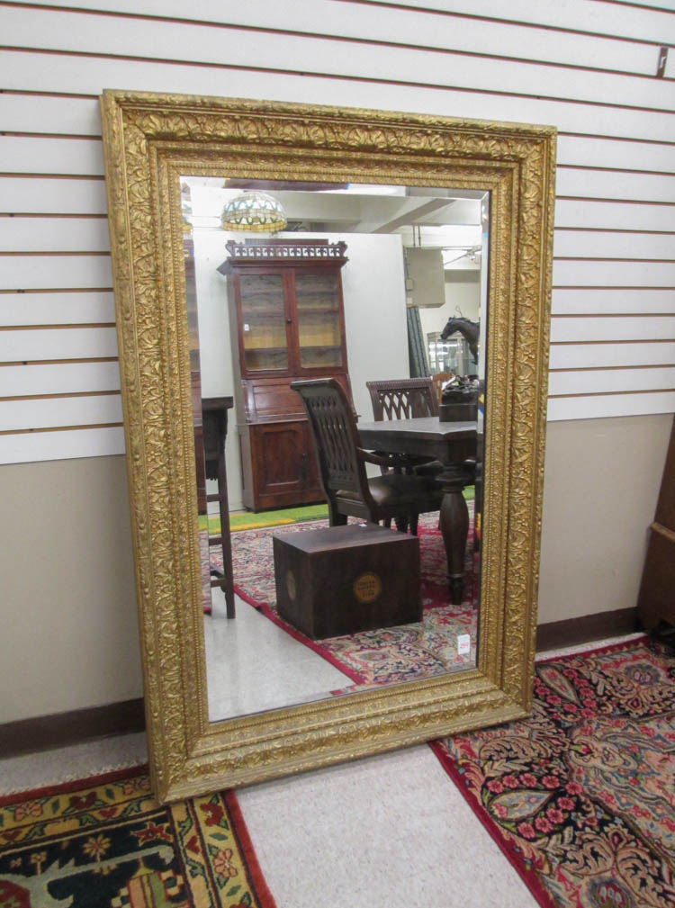 A LARGE GOLD FRAME WALL MIRROR, American, late 19t