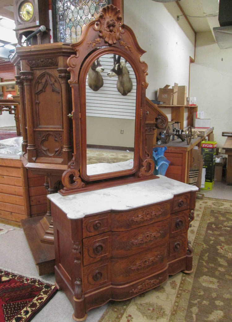 A VICTORIAN MARBLE-TOP WALNUT DRESSER WITH MIRROR,