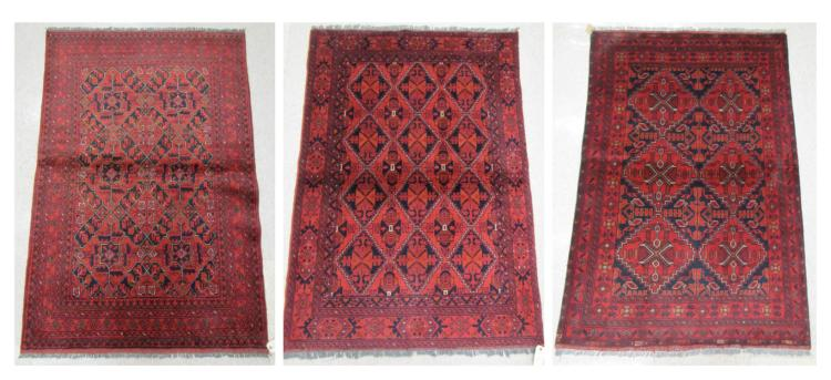 THREE AFGHAN BELOUCH AREA RUGS, both geometric des
