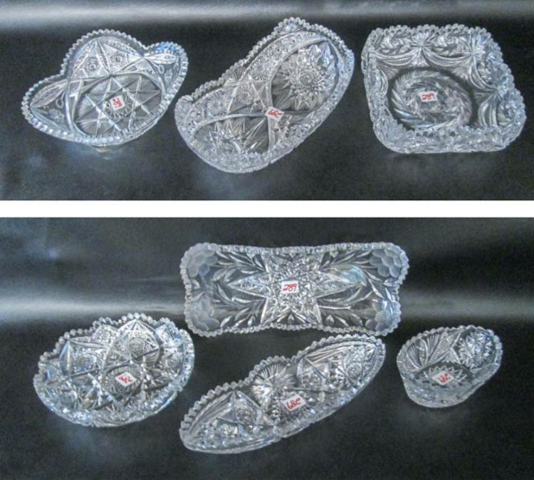 SEVEN CUT CRYSTAL TABLEWARE PIECES including one n