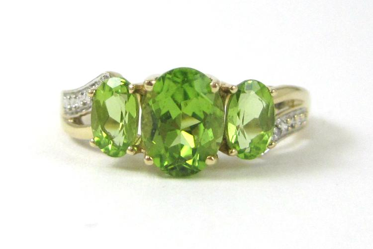 PERIDOT, DIAMOND AND TEN KARAT GOLD RING, with one