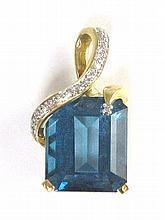 BLUE TOPAZ, DIAMOND AND TEN KARAT GOLD PENDANT,