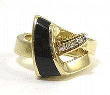 BLACK ONYX, DIAMOND AND FOURTEEN KARAT GOLD RING,