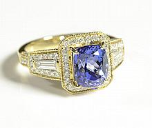 TANZANITE, DIAMOND AND FOURTEEN KARAT GOLD RING,